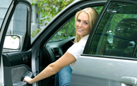 woman in a new car Top 7 Auto Loan Myths